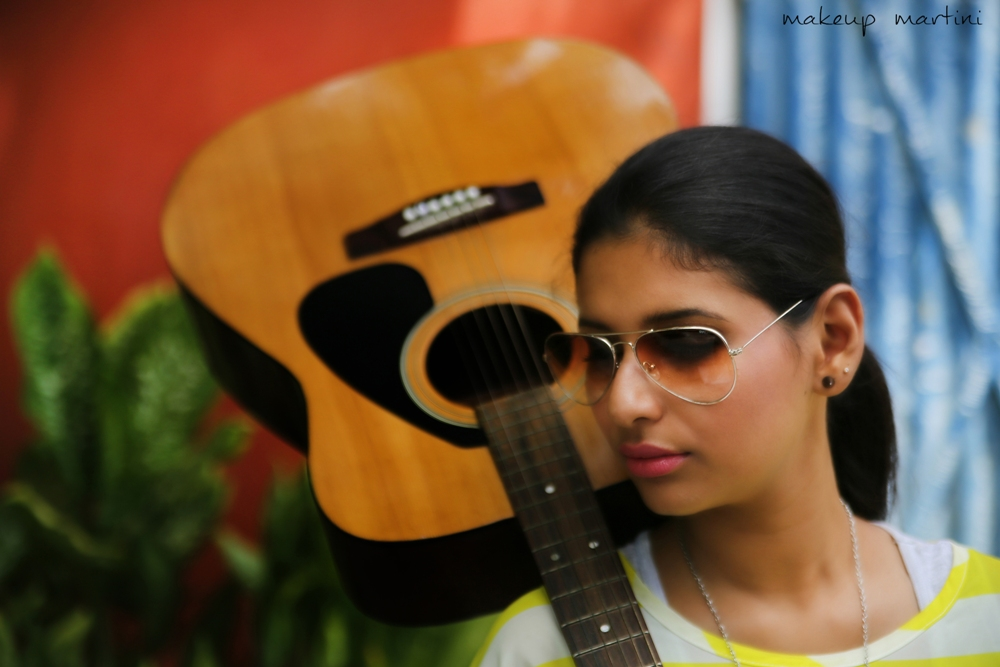 casual top and guitar closeup